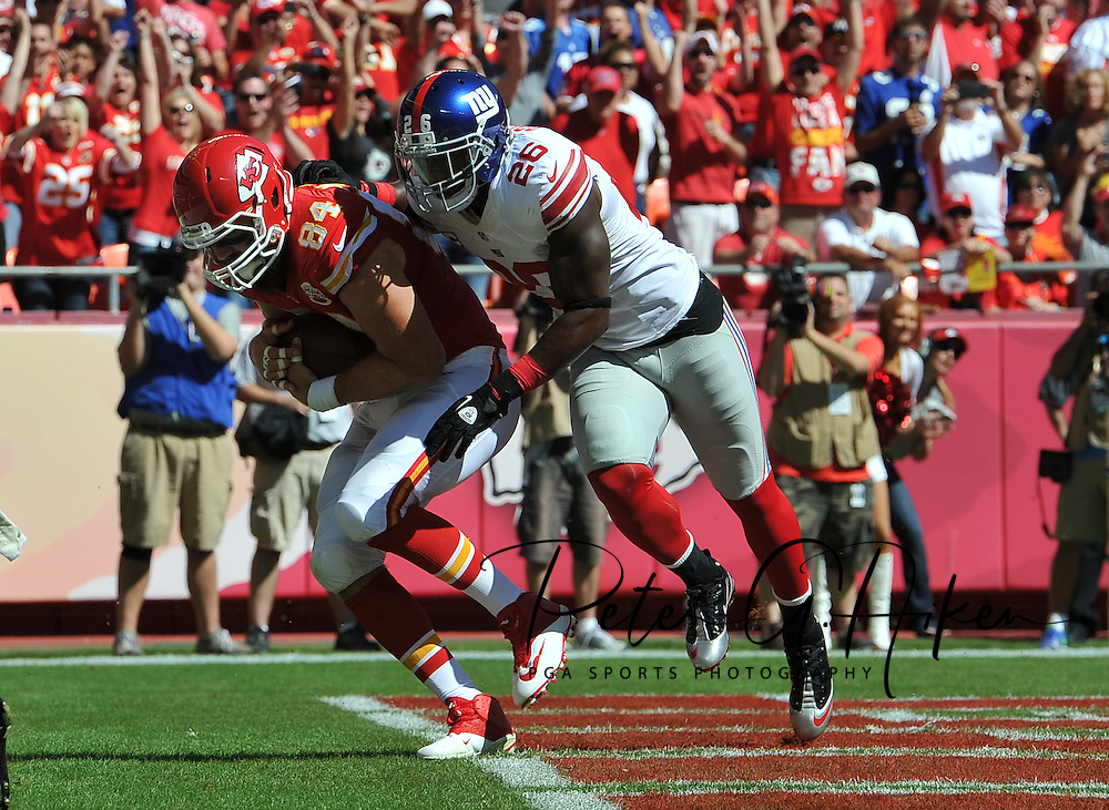 KANSAS CITY, MO - SEPTEMBER 29:  Tight end Sean McGrath #84 of the Kansas City Chiefs catches a 5-yard touchdown pass against strong safety Antrel Rolie # 26of the New York Giants during the first half on September 29, 2013 at Arrowhead Stadium in Kansas City, Missouri.  (Photo by Peter Aiken/Getty Images) *** Local Caption *** Sean McGrath;Antrel Rolie