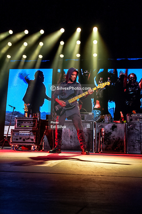 LOS ANGELES, CA - JUNE 20: Bass player Juan Calleros of legendary Mexican Rock band Mana perfoms on stage during their Cama Incendiada Tour at Staples Center on June 20, 2015 in Los Angeles, California. Byline, credit, TV usage, web usage or linkback must read SILVEXPHOTO.COM. Failure to byline correctly will incur double the agreed fee. Tel: +1 714 504 6870.