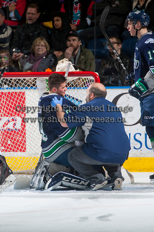 KELOWNA, CANADA - FEBRUARY 13: Matt Berlin #29 of the Seattle Thunderbirds is assessed by athletic trainer Phil Varney on the ice after colliding with a Kelowna Rockets player on February 13, 2017 at Prospera Place in Kelowna, British Columbia, Canada.  (Photo by Marissa Baecker/Shoot the Breeze)  *** Local Caption ***