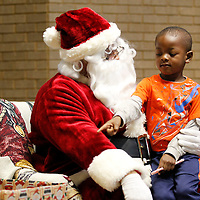 Thomas Wells | BUY at PHOTOS.DJOURNAL.COM<br /> Eli King asks a stuffed animal after he tells Santa he's been good as he and students from Haven Acres Head Start and Shannon Primary get to meet Santa at Renasant Bank in downtown Tupelo Monday.