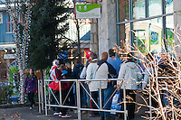 People line up around the Olympic Store in Whistler to purchase official merchandise during the 2010 Olympic Winter Games in Whistler, BC