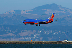 Boeing 737-7H4 (N251WN) operated by Southwest Airlines landing at San Francisco International Airport (KSFO), San Francisco, California, United States of America
