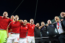 LILLE, FRANCE - Friday, July 1, 2016: Wales players celebrate in the team huddle following a 3-1 victory over Belgium and reaching the Semi-Final during the UEFA Euro 2016 Championship Quarter-Final match at the Stade Pierre Mauroy. Goalkeeper Daniel Ward, James Collins, David Edwards, David Vaughan, Ben Davies, equipment manager David Griffiths, Doctor Rhodri Martin, Mike Murphy, head of international affairs Mark Evans. (Pic by David Rawcliffe/Propaganda)