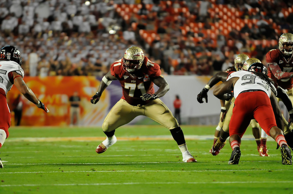 January 1, 2013: Menelik Watson #71 of Florida State in action during the NCAA football game between the Northern Illinois Huskies and the Florida State Seminoles at the 2013 Orange Bowl in Miami Gardens, Florida. The Seminoles defeated the Huskies 31-10.