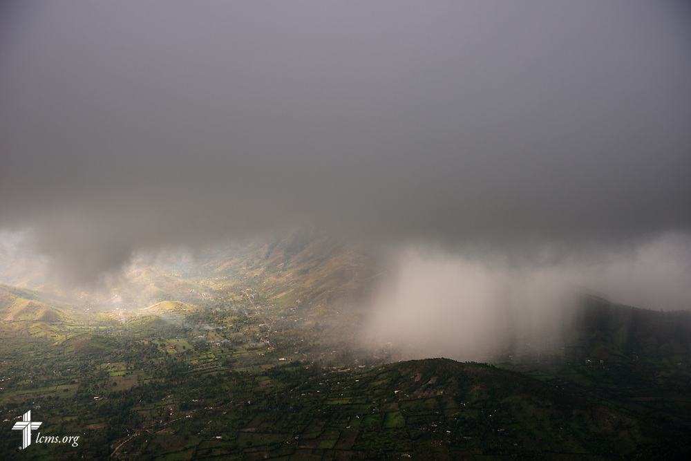 A storm passes over the region in Haiti on Tuesday, Oct. 11, 2016, seen through a light aircraft.  LCMS Communications/Erik M. Lunsford