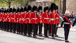 © Licensed to London News Pictures. 10/05/2015. London, UK. Grenadier Guards lead the war veterans and servicemen parade through Whitehall as part of the VE Day, 70th anniversary celebrations. Photo credit : Stephen Chung/LNP