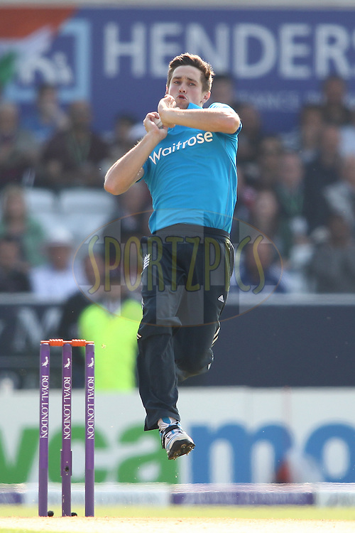 Chris Woakes of England sends down a delivery during the 5th One Day International ( ODI ) match between England and India held at Headingley Cricket Ground in Leeds, England on the 5th September 2014<br /> <br /> Photo by Shaun Roy / SPORTZPICS/ BCCI