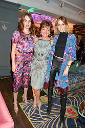 Left to right, LADY VIOLET MANNERS,  her mother the DUCHESS OF RUTLAND and LADY ALICE MANNERS at the Duresta For Matthew Williamson Exclusive Launch At Harrods, Knightsbridge, London on 10th March 2016.