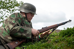 Reenactors portray panzer grenadiers from the elite German Großdeutschland Division during a private training weekend in 2011