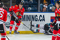 KELOWNA, BC - MARCH 02:  Cross Hanas #71 of the Portland Winterhawks checks a player of the Kelowna Rockets during first period at Prospera Place on March 2, 2019 in Kelowna, Canada. (Photo by Marissa Baecker/Getty Images)