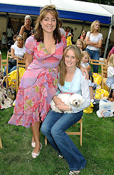 PANDORA COOPER-KEY and CRESSIDA BONAS daughters of Lady Mary-Gaye Curzon with their dog  at the Macmillan Cancer Relief Dog Day held at the Royal Hospital Chelsea South Grounds, London on 6th July 2004.