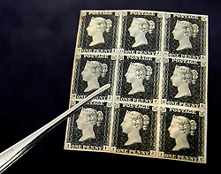 © Lisenced to London News Pictures. 01/09/2011. London, UK. A block group of 1840 Penny Black stamps is pictured at the Philatelic collection of Lord Steinberg at Sotheby's auction house, the stamps have an estimated value of £150,000-£200,000 GBP 170,000-226,000 Euros. They will be available in a series of two sales in London on 6-8 September and 21 September 2011. Photo: Shaun Curry/LNP/FNI