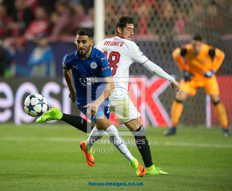 Riyad Mahrez of Leicester City (left) turns away from Sergio Escudero of Sevilla during the UEFA Champions League match at Ramon Sanchez Pizjuan Stadium, Seville<br /> Picture by Russell Hart/Focus Images Ltd 07791 688 420<br /> 22/02/2017