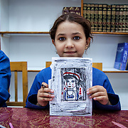 This young girl is a palestinian efugee from Syria, attending an UNRWA school in Zarqa, Jordan during the fall of 2013. Her telling drawing is part of a healing component in a classroom session for girls who experienced the traumas of war in Syria.