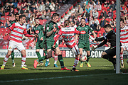Alfie May (Doncaster Rovers) gets a shot in as Luke McCormick (Captain) (Plymouth Argyle) closes him down and makes a vital save with seconds left in the first half during the EFL Sky Bet League 2 match between Doncaster Rovers and Plymouth Argyle at the Keepmoat Stadium, Doncaster, England on 26 March 2017. Photo by Mark P Doherty.