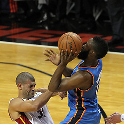 Jun 19, 2012; Miami, FL, USA; Oklahoma City Thunder guard James Harden (13) drives into Miami Heat small forward Shane Battier (31) during the second quarter in game four in the 2012 NBA Finals at the American Airlines Arena. Mandatory Credit: Derick E. Hingle-US PRESSWIRE