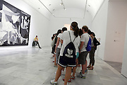 school group looking at the painting Guernica by Pablo Picasso, Museo Nacional Centro de Arte Reina Sofia Madrid Spain