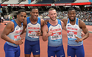 Jul 21, 2019; London, United Kingdom; Members of the Great Britain 4 x 100m relay pose after winning in 37.60 during the London Anniversary Games at London Stadium at  Queen Elizabeth Olympic Park. From left: Chijindu Ujah, Zharnel Hughes, Richard Kilty and Nethaneel Mitchell-Blake.
