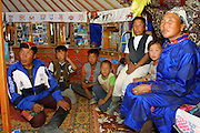 GOBI DESERT, MONGOLIA..08/29/2001.Tzochorinam, gers belonging to the family of wealthy camel herder and local hero Chimiddorj (l.). Chimiddorj's wife Maamhu (in blue dell), kids..(Photo by Heimo Aga).