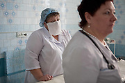 Doctor and nurse in Gomel Childrens regional hospital,Belarus. Chernobyl's human costs are widespread affecting about seven million people.A generation later children are being born with birth defects ,heart problems and thyroid cancer.The crippled economy of Belarus has led to poverty, social problems and domestic abuse..Photograph by Eamon Ward