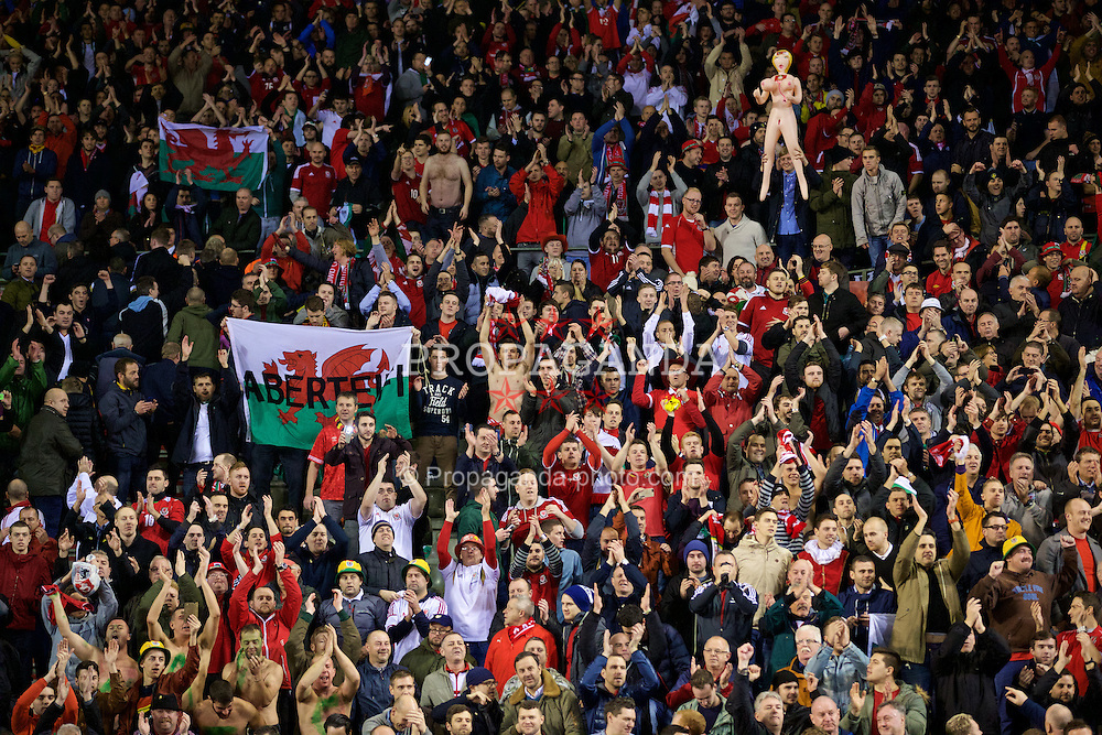 BRUSSELS, BELGIUM - Sunday, November 16, 2014: Wales supporters celebrate a point and staying top of the group after the final whistle of a goal-less draw against Belgium during the UEFA Euro 2016 Qualifying Group B game at the King Baudouin [Heysel] Stadium. (Pic by David Rawcliffe/Propaganda)