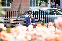 © Licensed to London News Pictures. 27/06/2015. Leeds .UK. Picture shows office workers enjoying the morning sun in Park Square in Leeds. Britain is set to sizzle in temperatures of up to 34C (93F) today, with forecasters predicting the hottest day for several years. A tropical air mass moving from North Africa, Spain and Portugal means that we could be hotter than Rio de Janeiro.Photo credit : Andrew McCaren/LNP
