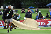 Ground Staff of Bay Oval bring in the covers as rain sets in during the Indian innings during the ICC U-19 Cricket World Cup 2018 Finals between India v Australia, Bay Oval, Tauranga, Saturday 03rd February 2018. Copyright Photo: Raghavan Venugopal / © www.Photosport.nz 2018