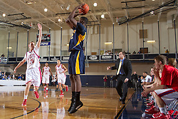 Northeast's Alex Poythress, right, shoots a three point basket in the first half. Lafayette hosted Northeast (TN)  Saturday, Jan. 07, 2012 at Lexington Catholic Gym in Lexington.