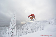 Female snowboarder catches air at Whitefish Mountain Rsort in Montana model released