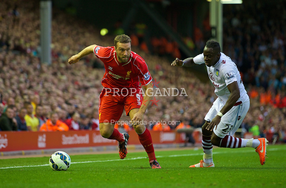 LIVERPOOL, ENGLAND - Saturday, September 13, 2014: Liverpool's Rickie Lambert in action against Aston Villa's Aly Cissokho during the Premier League match at Anfield. (Pic by David Rawcliffe/Propaganda)