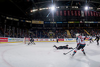 KELOWNA, CANADA - FEBRUARY 14: Dawson Barteaux #5 slides in front to block a shot on Riley Lamb #33 of the Red Deer Rebels by Kyle Topping #24 of the Kelowna Rockets  on February 14, 2018 at Prospera Place in Kelowna, British Columbia, Canada.  (Photo by Marissa Baecker/Shoot the Breeze)  *** Local Caption ***