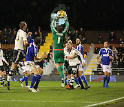 Ipswich goalkeeper Dean Gerken saving a corner with Ross McCormack looking on during the Sky Bet Championship match between Fulham and Ipswich Town at Craven Cottage, London, England on 15 December 2015. Photo by Matthew Redman.
