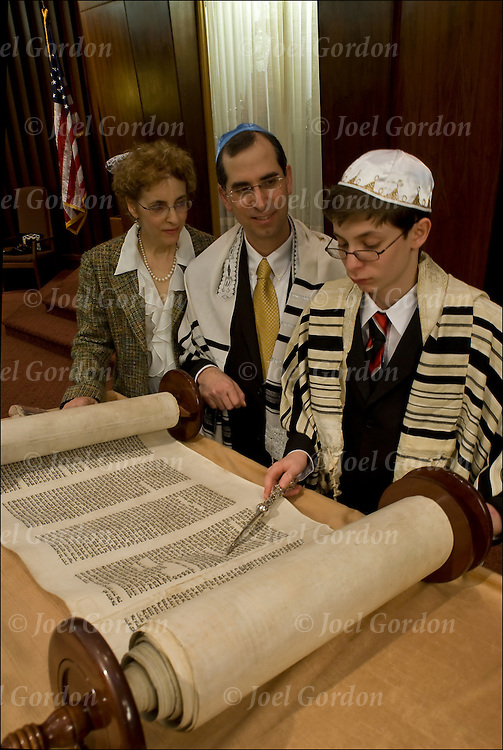Parents with Langston, Bat Mitzvah boy, in synagogue reading from the Torah, the ceremony admitting Jewish boy as an adult into Jewish Community, at age 13.<br /> <br /> Langston Aaron Salz Gering -  Bar Mitzvah on 2/5/10.