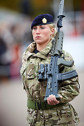 A female soldier on parade at the Afghanistan Medal Presentation. the Dalton Barracks,Abingdon, Abingdon, United Kingdom. Thursday, 31st October 2013. Picture by i-Images