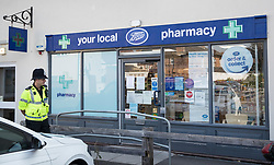 © Licensed to London News Pictures. 04/07/2018. Amesbury, UK. A police officer stands outside a closed branch of Boots the chemist after a couple named locally as Dawn Sturgess, 44, and her partner Charlie Rowley, 45, were taken ill on Saturday 30th June 2018. Police have confirmed that the couple have been in contact with Novichok nerve agent. Former Russian spy Sergei Skripal and his daughter Yulia were poisoned with Novichok nerve agent in nearby Salisbury in March 2018.Photo credit: Peter Macdiarmid/LNP