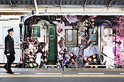 Takamatsu, February 17 2014 - The Araki Train runs between Takamatsu and Kanonji, connecting Takamatsu to sites west of the city. The cars of this train have been wrapped in Nobiyoshi Araki's art to create art in motion.