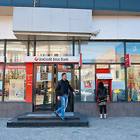 TIMISOARA, ROMANIA - APRIL 21:  A man leaves the main branch of the Unicredit Tiriac Bank  on April 21, 2013 in Timisoara, Romania.  Romania has abandoned a target deadline of 2015 to switch to the single European currency and will now submit to the European Commission a programme on progress towards the adoption of the Euro, which for the first time will not have a target date. (Photo by Marco Secchi/Getty Images)