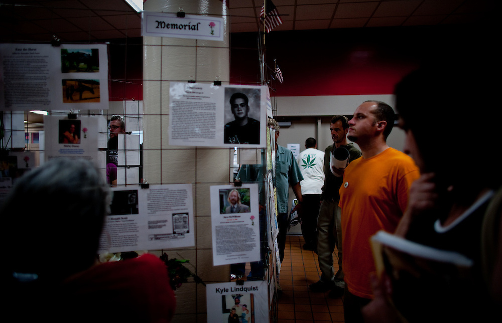 Attendees read stories and pictures of people sentenced to prison for marijuana related cases that were put on display at the entrance of the building...2010 International Cannabis and Hemp Expo (INTCHE) is a public education event that offers a forum for awareness, education, advancement of the hemp industry and medical cannabis community.  This event is largest blitz for public awareness ever launched in the Bay Area.  Taking place at Cow Palace, the event offers a patient consumption area and VIP Lounge with approved onsite consumption, guest speakers such as community leaders, activists, celebrities, experts and politicians and hundreds of vendors from various section of industries.