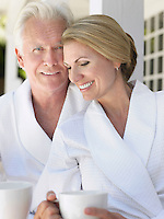 Couple standing on verandah portrait