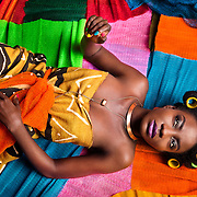 "The Net Girls is the birth child of a ""What If Moment"".  In Ghana, street hawkers sell all sorts but of all their wares, the nets are the most colorful. And here is what happens when creative minds get to work in treating the bathing nets (sponges) as couture. Photos: Nana Kofi Acquah MUA: Hamid Vijay  Stylist: Kelvincent Models: Laurie and Gina"