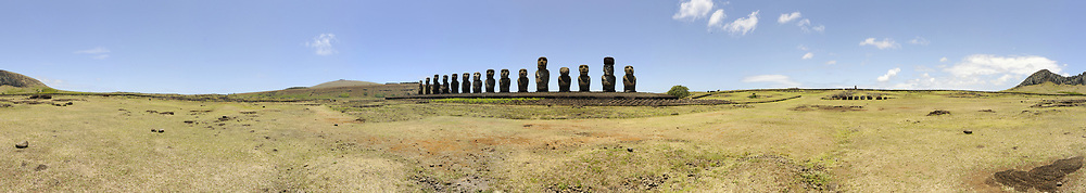 Easter Island (Rapa Nui: Rapa Nui, Spanish: Isla de Pascua) is a Polynesian island in the southeastern Pacific Ocean, at the southeasternmost point of the Polynesian triangle. A special territory of Chile that was annexed in 1888, Easter Island is famous for its 887 extant monumental statues, called moai, created by the early Rapanui people.<br /> <br /> On the Photo:  Ahu Tongariki is the largest ahu on Rapa Nui/Easter Island (a Chilean island in the Pacific). Its moai were toppled during the island's civil wars and in the twentieth century the ahu was swept inland by a tsunami. It has since been restored and has fifteen moai including an 86 tonne moai that was the heaviest ever erected on the island. Ahu Tongariki is kilometer from Rano Raraku and Poike in the Rapa Nui National Park. All the moai here face sunset during Summer Solstice.