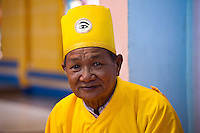Cao Dai preist wearing yellow to signify virtue and  represents the Buddhist aspects of Cao Dai.