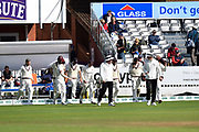 The umpires lead the players back on after a short rain delay during the Specsavers County Champ Div 1 match between Somerset County Cricket Club and Essex County Cricket Club at the Cooper Associates County Ground, Taunton, United Kingdom on 26 September 2019.