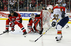Feb 28, 2009; Newark, NJ, USA; New Jersey Devils goalie Martin Brodeur (30) makes a save while Florida Panthers right wing Anthony Stewart (13) looks for the rebound during the second period at the Prudential Center.