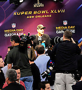 1/29/13 New Orleans LA.-BSan Francisco 49er's Head Coach Jim Harbaugh speaks to the wolrd media during Media Day for Super Bowl XLV11 at the the Mercedes Benz Super Dome for the NFC champion San Francisco 49ers's and the AFC Champions  Baltimore Ravens  prior to Super Bowl XLV11 in New Orleans. Photo©Suzi Altman