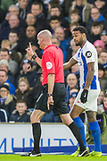 Jurgen Locadia (Brighton) continues a conversation with Lee Mason (Referee) as he raises his hand and walks away during the FA Cup fourth round match between Brighton and Hove Albion and West Bromwich Albion at the American Express Community Stadium, Brighton and Hove, England on 26 January 2019.