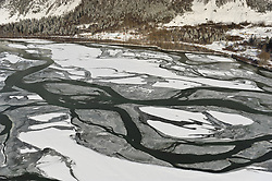 The many braids of the Chilkat River are visible in this aerial photo of the river taken near Haines, Alaska. The Chilkat River is a popular destination for photographers who come to the river in November and December to photograph one of the largest gatherings of bald eagles in the world.