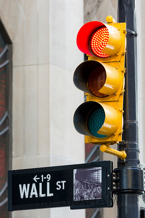 Red traffic light for STOP on Wall Street in New York, USA
