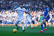 Mateusz Klich of Leeds United (43) in action with Craig Noone of Bolton Wanderers (12) nearby during the EFL Sky Bet Championship match between Leeds United and Bolton Wanderers at Elland Road, Leeds, England on 23 February 2019.