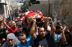 60372639 <br /> Palestinians carry the body of Majed Lahlouh during his funeral in the West Bank city of Jenin on Tuesday Aug. 20, 2013. Lahlouh was killed early Tuesday in clashes with Israeli forces that raided north West Bank, medical and security sources said, Tuesday August. 20, 2013.<br /> Picture by imago / i-Images<br /> UK ONLY